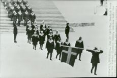 The Swedish squad marches after the fan carrier at the Bergisel Ski Stadium at the opening ceremony of the Winter Olympics in Innsbruck in 1964