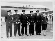 """The world's first jet-powered passenger plane """"de Havilland Comet"""" on its way to Johannesburg. The crew poses in front of the plane at London Airport"""