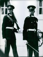 Two Military personnel on guard.