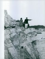 Prince Sadruddin Aga Khan standing on the coast with his wife Nina Dyer.