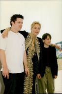 "Sharon Stone attends the Cannes Film Festival to promote her new movie ""The Mighty"", here she poses with Elden Henson and Kieran Culkin"