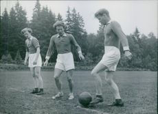 Footballers playing football on the ground and getting trained. 1947