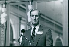 1996  A photo of James Crowwell giving speech during a scene in film Larry Flynt - scandals husband.