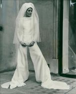 Fashions: bride wears the trousers.