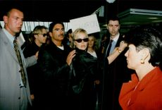 Actress Sharon Stone writes autographs to her fans on arrival at Nice with her husband Phil Bronstein