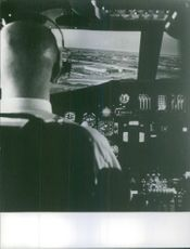 Photo of a Pilot sitting in the cockpit ready to take off.