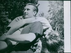 """Walther Fischer carrying a boy over his shoulders.  """"Walther Fischer""""  1944"""