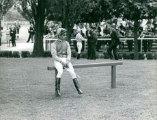 Yves Saint-Martin sitting on a slim bench.  Taken - July 1966