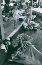 People in evacuation center during War in Laos. 1964