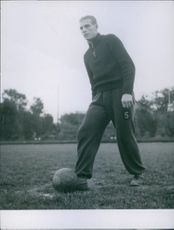 "Man doing exercise and playing football, kicking.  ""exercise ___""  1943"