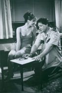 Annabella Sciorra and Sylvester Stallone in a scene from the movie Cop Land.