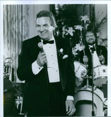 "A photo of Danny Aiello in a film ""Once Around"""