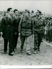 Ahmed Ben Bella with men and military officer.