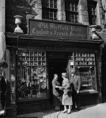 Old couple visited 'Old Sheffield & French Furniture' store.  - Jun 1954