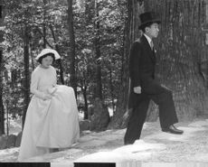 Prince Akihito in morning suit with silk hat with his wife Empress Michiko.