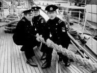 "The cadets Igor Takasov, Denise Manoli and Dimitri Panoff aboard the Soviet school ship ""Sedov"" on arrival at Stadsgårdskajen"