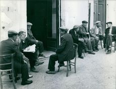 People sitting together and having discussion.