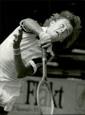 Action picture on tennis player Hans Simonsson taken in an unknown match context.