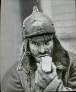 Russian prisoner eating bread during the Finnish-Russian War. 1939-40