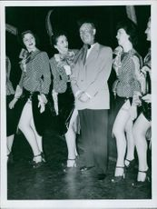 Maurice Chevalier with women.