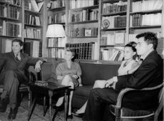 Jacques Monod sitting with people.