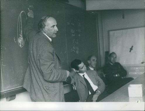 Professor Lowell teaching the seemingly bored military soldiers.