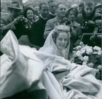 A photo of Princess Regina Saxony-of-Meiningen pose in her wedding attire in May 9 1951.