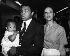 Muhammad Ali along with part of his family: his little daughter and wife Veronica.