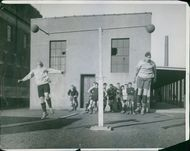 Vintage photo of men doing training for a sport.
