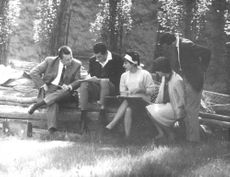 Jean-Claude Pascal with his friends, writing.