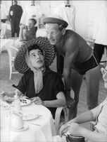 Danny Kaye talking to woman.