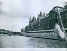 A view of Paris' old structured buildings along the river Siene.