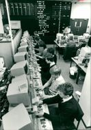 Schools 1980-1987:Busy schoolboys and girls work.