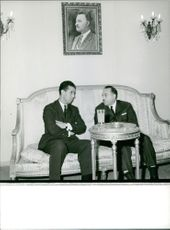 Two men chatting.  Photo taken July 9, 1962