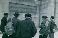 Men looking at a scripture on the wall. May 31, 1966.