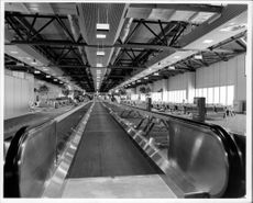 The T4 has increased Heathrow's capacity to 38 million passengers a year. Rollerbanks move the passengers into the vast terminal