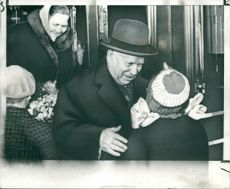 Mr. Khruschev and his wife.