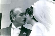 Eddie Barclay kissing his wife, 1965.
