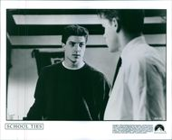 Brendan Fraser as David Greene in a conversation scene from the film School Ties.