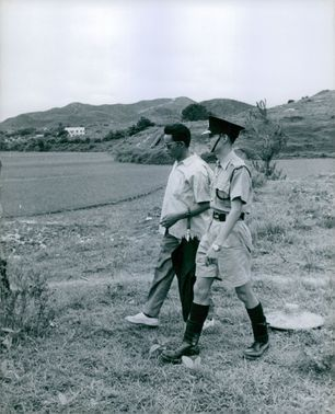 Soldier walking with a man in Vietnam