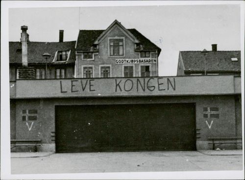 "Abandoned house with a writings ""Live the King""."