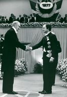 Nevill Francis Mott receives the Nobel Prize in Physics from King Carl Gustaf's hand