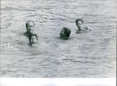 Valéry Giscard d'Estaing swimming with his family. 1963