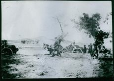 Soldiers on the open field during their battle.
