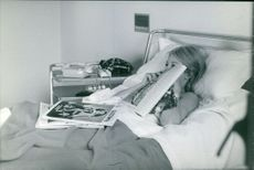 Sandra Milo is lying on bed in hospital.  Photo taken May 17, 1967
