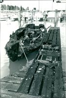 A burged out Yachts beside a charred jetty after the explosion.