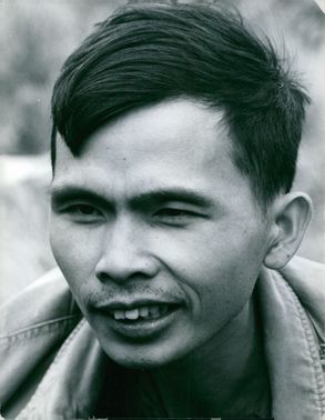 Vintage photograph of the Viet-cong leader smiling.