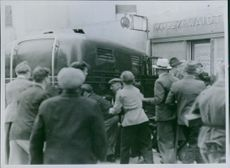 A commotion in the crowd of people during the German occupation in Denmark 1944