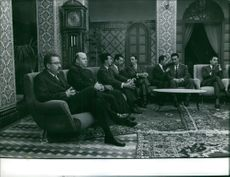 Ahmed Ben Bella sitting with few other men.  Taken - Mar. 1962