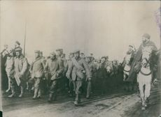 German soldiers marching in the field during WWI.